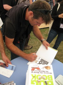 Nick Baker signing copies of the Bug Book on the NHBS stand, Birdfair 2011